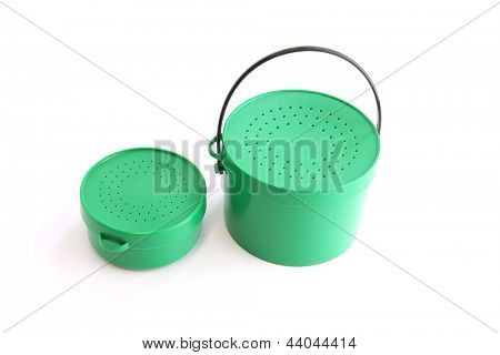 Two green tins with perforated lids