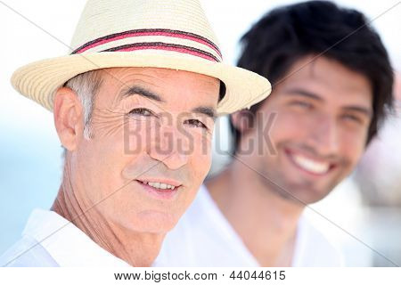 Father and son enjoying each other's company on a sunny summer's day
