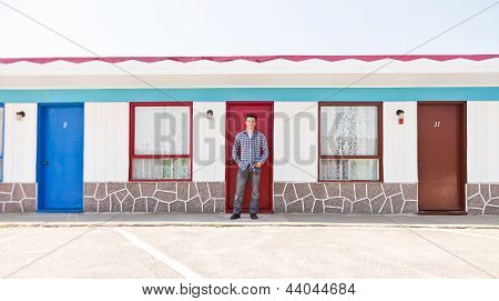 Young Man In Front Of The Red Door