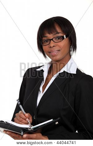 Eager businesswoman writing in her diary