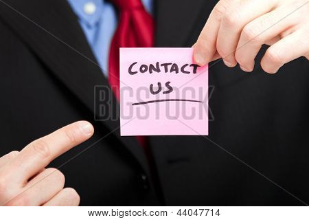 Businessman showing the words contact