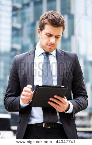 Portrait of a businessman using a tablet pc