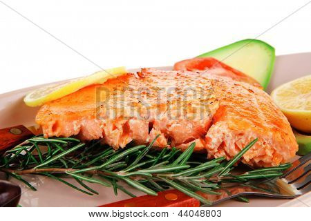 roast fish: hot grilled salmon on glass plate isolated on white background