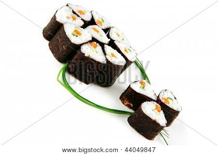 served shushi rolls on white background  with fennel