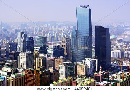 Downtown cityscape of Seoul, South Kore with smog in the distance.