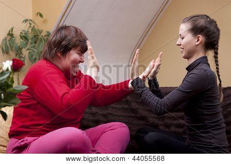Two Women Making Rhythm Exercises