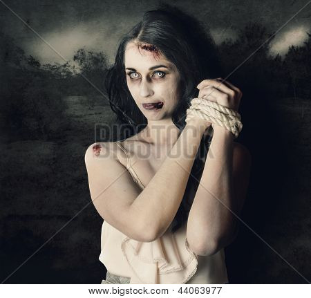 Dark Horror Scene Of An Evil Zombie Woman Tied Up