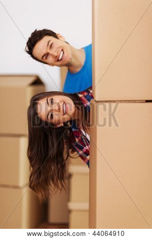 Couple having fun during moving in new home