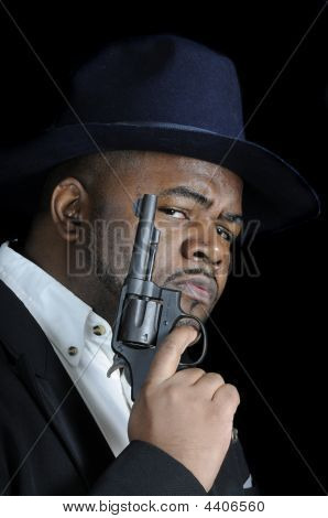 Young African American Man With Gun