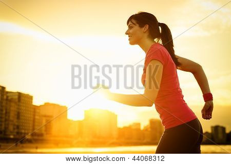 Woman Running On Summer Sunset