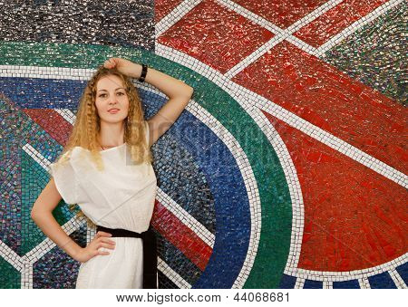 Woman Posing On Mozaic Background