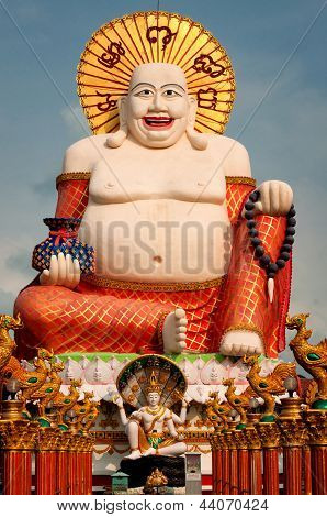 Fat Laughing Buddha Over Blue Sky