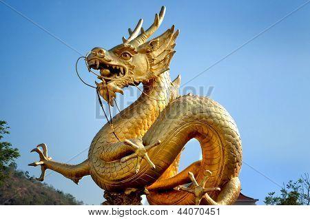 Golden Dragon Over Blue Sky