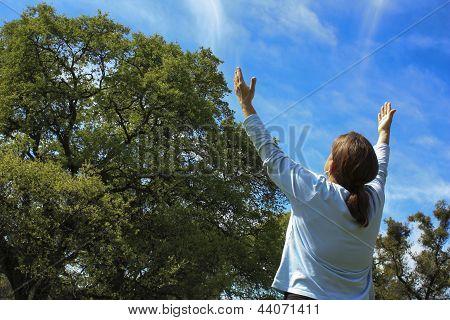 Woman Praising God Outside