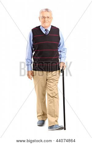 Full length portrait of a senior man walking with a cane, isolated on white background
