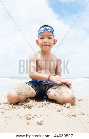 Playful Boy On The Beach With Sea  On Background..