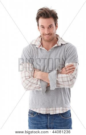 Casual young man looking questioningly at camera, smiling.