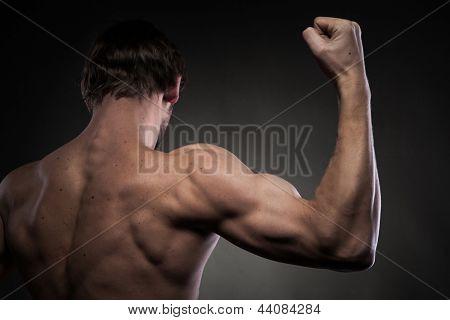 Power mens hand on black