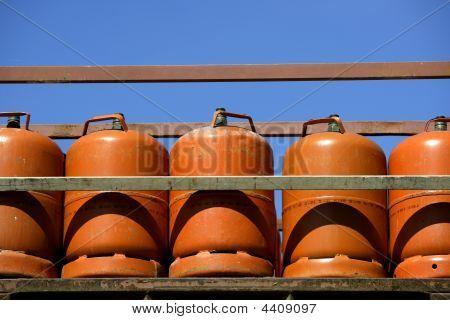 Botellas, Bombonas  Butano Color Naranja. Orange Gas Racks