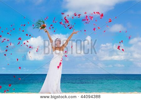 young happy smiling bride on the wedding day on tropical beach and sea background