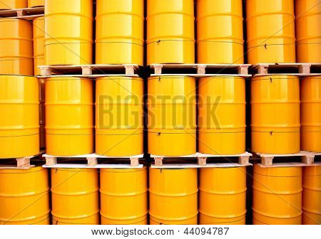 Yellow oil drums on an industrial transport site