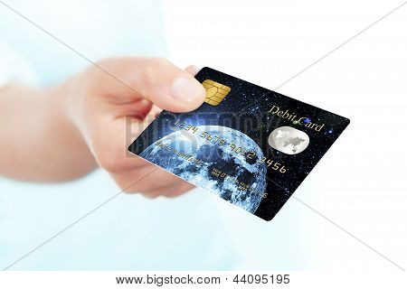 Debit Card Holded By Hand Over White