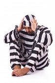 picture of inmate  - Inmate in stiped uniform on white - JPG