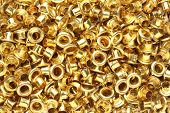 pic of eyeleteer  - Close up Abstract golden brass eyelets background - JPG