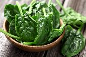 picture of plating  - Spinach leaves in a wooden plate - JPG