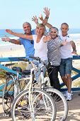 stock photo of 55-60 years old  - Carefree couples on vacation together - JPG