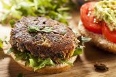 stock photo of veggie burger  - Homemade Organic Vegetarian Mushroom Burger with tomato and guacamole - JPG