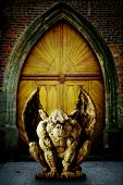 picture of gargoyles  - a statue of gargoyle guarding a temple gate - JPG