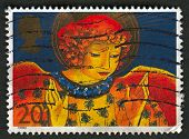 UK - CIRCA 1998: A stamp printed in UK shows image of An angel is a supernatural being or spirit, us