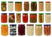 picture of pickled vegetables  - Collection of canned vegetables in glass jars isolated on white - JPG