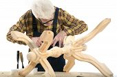 stock photo of woodcarving  - Old woodcarver work in the workshop - JPG
