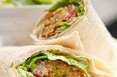 stock photo of bread rolls  - falafel pita bread roll wrap sandwich traditional arab middle east food - JPG