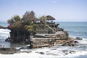 picture of tanah  - crowds of tourists around the tanah lot sea temple in bali indonesia - JPG