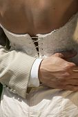 image of corset  - Wedding couple holding - JPG