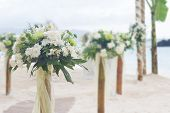 wedding flower post and decoration on beach