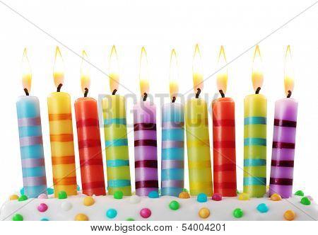 Ten birthday candles on white background