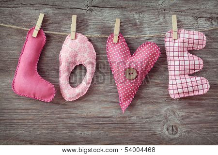 Letters love on wooden background