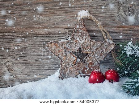 Wooden christmas star on wooden background