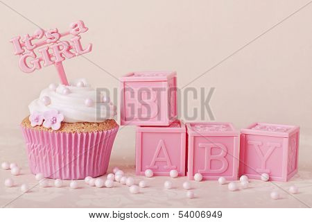 Cupcake with a cake pick and baby cubes