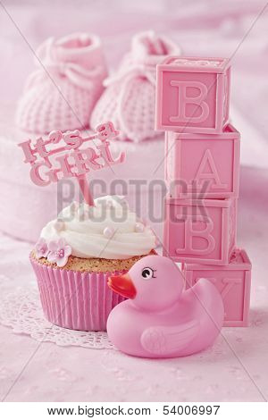 Cupcake with a cake pick and baby decoration
