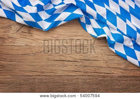 Oktoberfest blue checkered fabric on wooden background