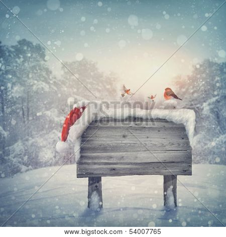 Wooden sign and santa hat in winter forest