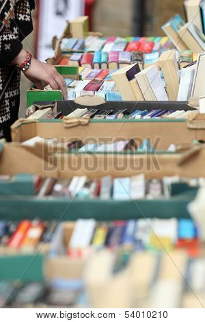 Looking through old books in a second hand book sale