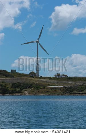 Wind turbine next to lake