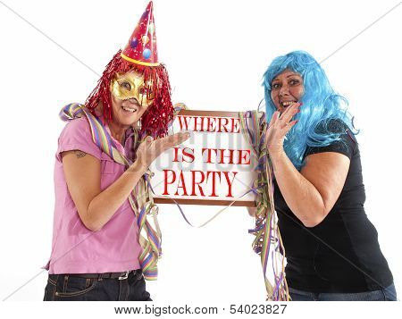 Two Cheerful Ladies In Party Mood With A Billboard