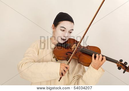 The Clown Is Playing The Violin